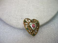 Vintage Gold Tone Filigree Heart Brooch with an Enamel Rose Center. , Mid-Century. Rhinestone Accents