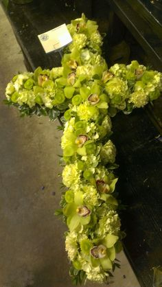 A floral cross for to remember them. americasflorist.com