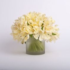 CREAM TULIPS - Clean and chic cream tulips set inside a frosted glass vase. Tulips Variety will vary depends on availability.