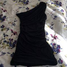 Black one shoulder dress Black one shoulder mini dress . 90% polyester, 10 percent spandex. Tight fit, juniors size large. Excellent condition-worn only once. Forever 21 Dresses One Shoulder