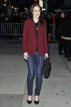 """""""Downtown Abbey"""" star Michelle Dockery changes into a casual outfit as she leaves """"The Late Show With David Letterman"""" in New York where she was a guest.  The happy and polite Dockery signed autographs for fans before making her exit."""