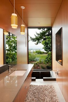 I'm not much for one on baths but this is stunning & I could for sure see myself soaking in there w/ that view. (Ellis Residence by Coates Design Architects Seattle)