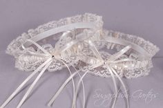 A bridal garter set in ivory satin and lace ~ perfect for the traditional bride!