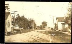 1928 Alba Michigan street scene real photo postcard, chickens in dirt road