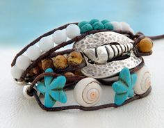 Conch... Leather wrap bracelet... Beaded triple wrap bracelet. Original OceanBead Style.