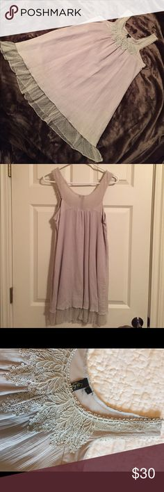Lu Luvia Sleeveless Tunic with Lacy Detail Color is light grey with a little blue hue to it. Scoop neck and sleeveless, there is lacy detail along neckline. Fully lined with a lacy hem accent. Excellent condition! Lu Lu Via Tops Tunics