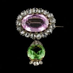 Brooch set in gold and silver with pink topaz and diamond surround with a removable peridot pendant, circa Edwardian Jewelry, Antique Jewelry, Vintage Jewelry, Gems Jewelry, Bling Jewelry, Jewelery, Suffragette Jewellery, Pink Topaz, Royal Jewels