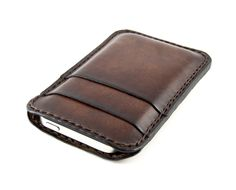The perfect iPhone5 case for those who enjoy the look and feel of the device itself. Entirely handcrafted in Italy. Genuine Italian vegetable tanned leather. Stitched by hand with heavy-duty thread – stitching available in black, dark brown, brown, light brown, cream or white. The case features a central slot that accommodates the iPhone5, 2 anterior slots for cards and one bigger posterior slot for documents or cash. Simplify your accessories without sacrificing style or quality.