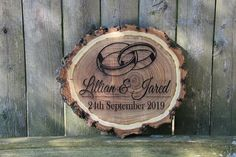 Beautifully engraved real wood log can be hung or displayed on a stand. Laser engraving will not fade, crack, or peel. Custom order requests are gladly accepted. Let's make It Personal! #woodweddingsign #engravedlogslice #customplaque #weddinggifts #rusticweddingdecor #keepsakegift #weddingbands #giftfornewlyweds #personalizedgifts #forbrideandgroom #justmarried #forcouples #valentinesdaygift