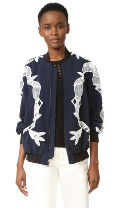 ¡Cómpralo ya!. Jonathan Simkhai Bomber Jacket With Applique - Navy Combo. Lace appliqués bring striking contrast to this loose Jonathan Simkhai bomber jacket. Snug ribbing cinches the edges. Zip closure and 2 pockets. Long sleeves. Lined. Fabric: Mid weight crepe. Shell: 51% acetate/46% viscose/3% elastane. Trim 1: 100% polyester. Trim 2: 86% viscose/10% polyamide/4% elastane. Lining: 100% silk. Dry clean. Imported, China. Measurements Length: 25.25in / 64cm, from shoulder Measurements…