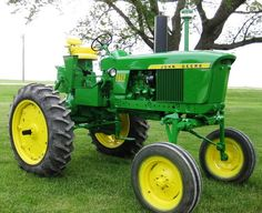 This extremely rare 1971 John Deere 2520 high crop diesel tractor was the top lot in the two-day sale of John Deere vintage tractors and related collectibles held July 8-9 in Le Mars, Iowa, selling for $64,000