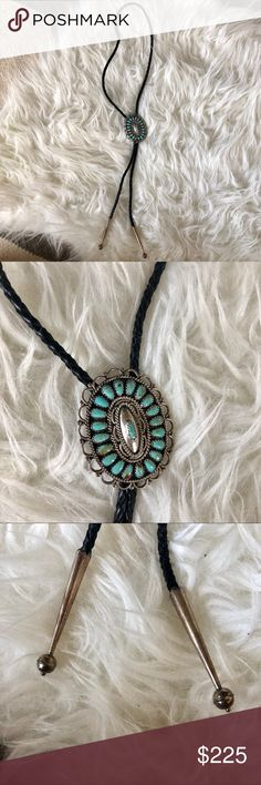 Vintage Navajo turquoise sterling silver bolo tie Signed LMB Sterling. This Larry Moses Begay is a Native American Navajo Zuni artist. This Sterling Silver with turquoise bolo tie has beautiful dark brown cording with sterling silver cased ends. Has a natural patina from age that I did not try to clean in order to preserve the integrity of the piece. But should you want a shiny new look the piece can be polished and look perfect. Measurements are listed in the comments below. Vintage Jewelry…