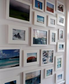 for our dining room - find a bunch of frames cheap and paint them uniform, then hang all those photos!  from: photo wall | the style files