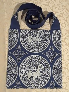 Bag made from blue cotton canvas, lined, printed with a hand carved century middle eastern lioness stamp and a century filler stamp. Lighted Canvas, 11th Century, Blue Fabric, My Works, Bag Making, Cotton Canvas, Hand Carved, Medieval, Workshop