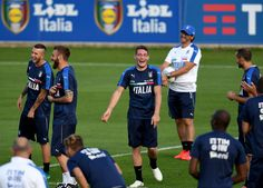 Andrea Belotti of Italy (C) smiles during a training session at the club's training ground at Coverciano on October 3, 2016 in Florence, Italy.
