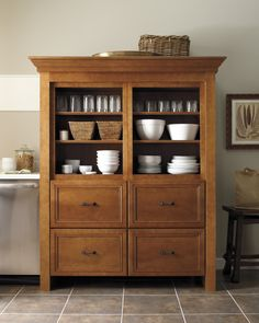 Instead of hiding vintage dishes away inside stark cabinetry, place your tableware on display in an aged armoire. Whether the piece was discovered at the local flea market or is merely a clever replica, the article will add authenticity to your country kitchen.