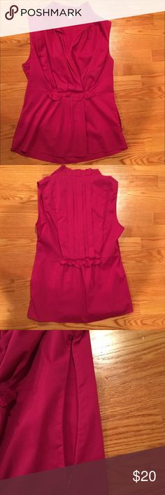 Banana Republic Pink Sleeveless Ruffle Top Pink Banana Republic Sleeveless Top. Side zip. Ruffle details in front and back. EUC! Worn once. Ask any questions you may have. From a clean, smoke and pet free home. Banana Republic Tops