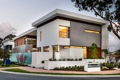 flat roof grey stucco grey wall white wall frosted glass panel skinny glass window landscape of Stunning Modern White House Ideas that People Look for