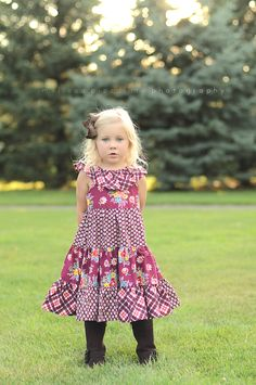 Create Kids Couture's Lorelais Tiered Ruffle Neck Dress pattern is a classic, fun look that lets you mix and match your favorite fabrics! It's great for warmer weather, but it's also adorable with a long sleeve shirt and boots!