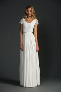 simple white wedding dress with cap sleeves, scoop neck, and ribbon sash