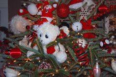 Christmas tree done in red and white with lots of stuffed toys and animals. Cute large eyes on this one.