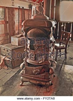 Vintage stove in abandoned barn in sepia colors on wooden floor. Coal Stove, Primitive Dining Rooms, Stove Heater, Sepia Color, Cast Iron Stove, Vintage Stoves, Antique Stove, Cooking Stove, Vintage Appliances