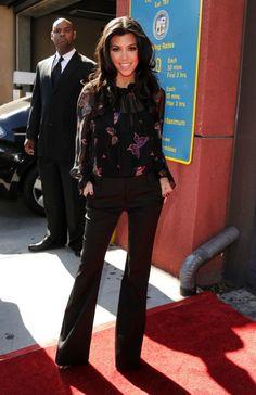 Kourtney Kardashian wearing Prada Leopard Platform Pump Corey Lynn Calter Elisa Ruffle Poet Blouse L agence trousers BLACK