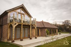 Oak balcony with glazed railing allow uninterrupted views House With Balcony, Porch And Balcony, Bungalow Extensions, House Extensions, Cottage Extension, Oak Framed Buildings, Oak Frame House, Waterfront Cottage, Lakeside Living