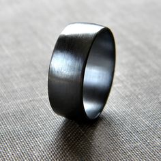 Brushed men's oxidised silver ring.