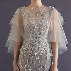 Handmade to order. Material: Tulle Measurements and special instructions handled by phone.