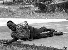 """James Meredith, the first Black student admitted to the University of Mississippi, attempted to launch a """"March Against Fear"""" in the spring of 1966 to highlight the changes in the South.  Shortly after crossing the Mississippi border, he was shot by a sniper hiding on the roadside.  Meredith survived the shooting, and other civil rights activists continued the march. Courtesy of Veterans of the Civil Rights Movement website."""