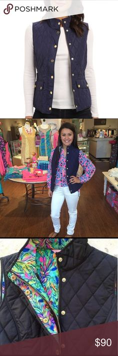 Getaway Quilted Vest The Getaway thin quilted vest is everything you are been looking for in a feminine vest. This slimming vest comes in rich colors and in true Lilly fashion, a printed lining. There's no need to settle for boring or basic when you can have fun and feminine. True navy. No signs of wear. Lilly Pulitzer Jackets & Coats Vests