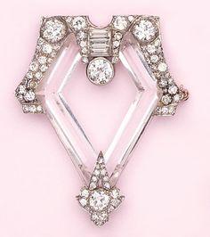 Dramatic rock crystal, diamond and platinum brooch.