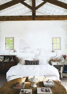 Love the contrast between these reclaimed trusses and the white background!