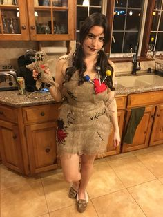 Voodoo doll costume. Bought a cheap dress at value village and then bought burlap material that I glued overtop. The other accents are made from red and black fabric and yarn. The pins are straws and styrofoam balls. Such a cute costume and no one else was a voodoo doll all night!