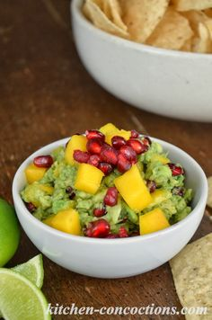 Kitchen Concoctions: Mango Pomegranate Guacamole Recipe- Classic guacamole gets a festive twist perfect for holiday dinner parties.