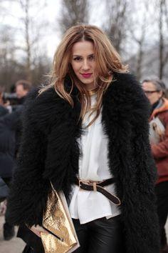 black pants, white jumper, belt, big fur coat, gold accessories