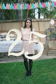 DIY 25th birthday sign: Made out of cardboard and spray painted with gold and sprinkled with glitter.