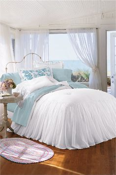 This beautiful blue and white bedroom would look great with embossed white tin ceilings.