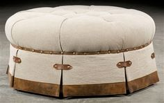 Grand home tufted round ottoman.