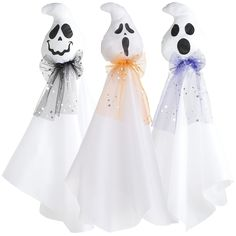 Inspiration: Pier1 Ghosts. Should be easy to replicate with white fabric, black paint, tuelle, sequins, and a sewing machine.