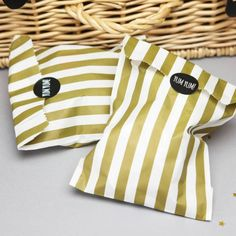 Gold Stripy Sweet Bags With Stickers - Treat everyone even more with these glitzy gold stripy sweetie bags and black 'yum yum' stickers. Whether you're hosting a wedding or a sparkly birthday bash these bags are the perfect addition. #goldparty #goldpartybags #partybags #metallicparty