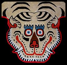 Traditional Tibetan Tiger Rugs from the Himalayan regions | Available at Garuda Trading - The Tibetan Buddhist Shop