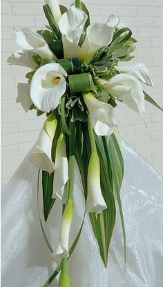 Cascading calla bouquet with folded aspidistra and lily grass.