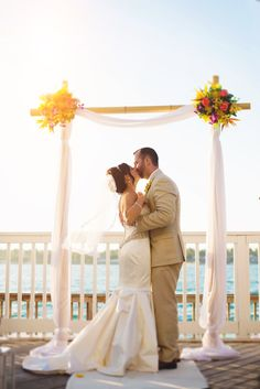 Bamboo Arch with Tropical Floral by Love In Bloom Florist at Ocean Key Resort, Key West