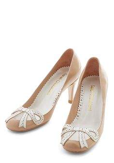 Let Me Introduce Myself Heel-- Striding confidently in these bow-topped heels from Sarah Chofakian, you greet your new coworkers with a strong handshake and a winning smile! Give an introduction as charming as these beige pumps, which feature an ivory, cutout-adorned bow atop their leather upper. Handmade by artisans, this lovely pair lets your charismatic optimism shine!