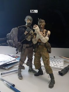 "Ashley Wood about these two figures: ""Here is quick shot of SGR-JC and Moon Ronin TK, hanging on my desk, no staging or fancy camera work, just two fun toys! The astute 3A fan will notice the beards, a mainstay of great 12″ figures and even 8″ such Action Jackson with MOD STYLED HAIR! Thats some shit-hot heritage right there!"""
