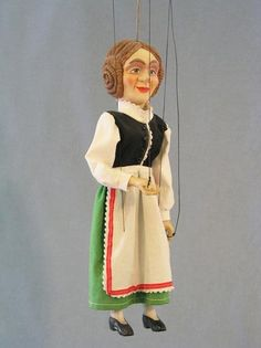 Decorative puppets and marionettes used as interior decoration, as a toy, souvenir or an original gift.