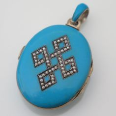 An Antique Victorian Silver and Blue Enamel Seed Pearl Locket.