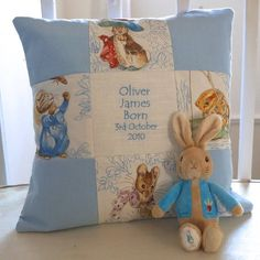 <em><strong>A Gorgeous gift set for a new baby!</strong></em>This delightful nursery cushion features Beatrix Potter© characters and is embroidered with the child's name and date of birth. You can choose from Flopsy Bunny or Peter Rabbit which will come tied to the cushion in a satin bow. Please note that the characters may vary. Available in Natural, Pink or Blue. Size: 35cm <em>Beatrix Potter TM ©Frederick Warne & Co., 2001. Licenced by Copyrights Group</em> <em><strong>PLEASE NOTE: Our…